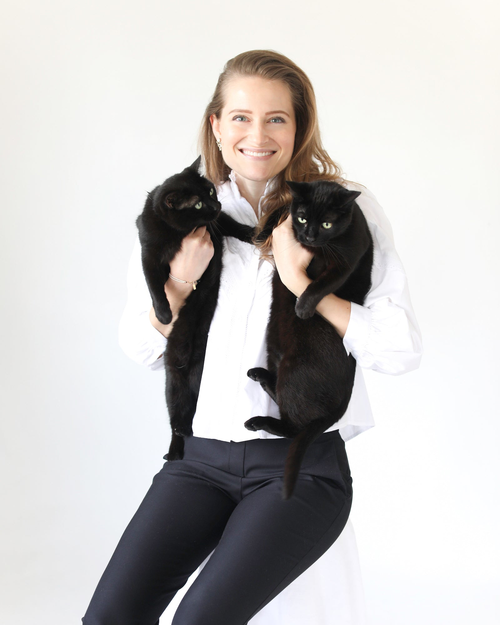 Meredith Swinehart founder of Faunamade with two black cats
