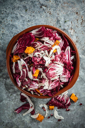 Shaved fennel, pumpkin, nigella seeds, pomegranate, radicchio, herb vinaigrette salad
