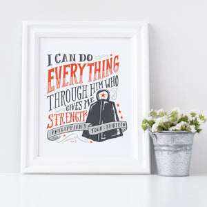 "Artwork in a white frame with the artwork printed on white paper and hand drawn lettering with the Philippians 4:13 ""I can do everything through him who gives me strength."" The lettering is in black and red."