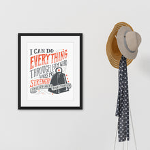 "Load image into Gallery viewer, Black framed artwork next to coat rack featuring a white paper print with black and red lettering featuring the Bible verse Philippians 4:13 ""I can do everything through him who gives me strength."""