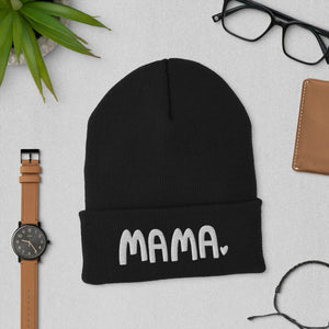 A black beanie winter hat featuring the word Mama with a small heart at the end of the word. The cozy hat makes a fun mother's day gift.