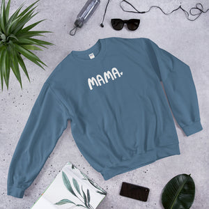 A cozy sweatshirt with the word Mama in white with a small heart. The sweatshirt is indigo blue.