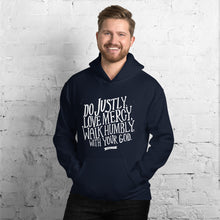Load image into Gallery viewer, A man wearing a navy hoodie with the Bible verse words Do justly, love mercy, walk humbly, with your God, Micah 6:8 in white lettering.