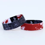 Load image into Gallery viewer, Blood splatter on one side and spiderwebs on the other of this reversible wristband