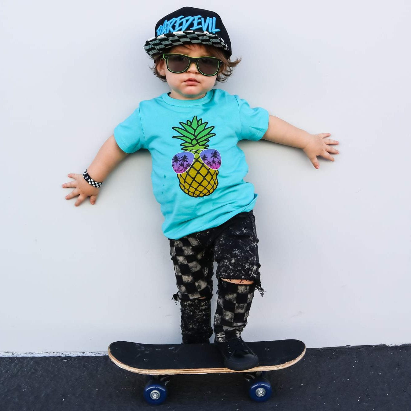 Boy graphic teal tee with pineapple sunglasses
