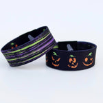 Load image into Gallery viewer, Halloween wristband with Pumpkin faces and beetlejuice colors on the reverse