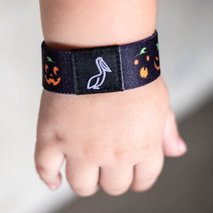 Halloween pumpkin elastic wristband and Beetlejuice colors on the reverse bracelet