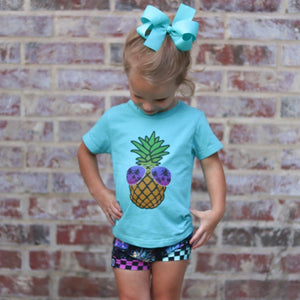 Pineapple wearing sunglasses on a short sleeve team tee for kids