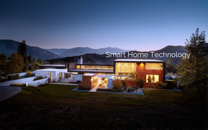 Luxury smart home exterior at sunset with mountains in background