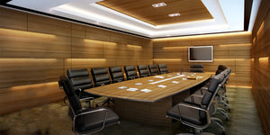 Modern wood conference room with large table and chairs and tv screen on wall and automated lighting