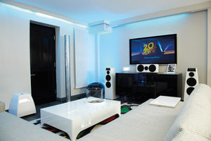 Modern white family room with large screen tv and white modern speakers and projector