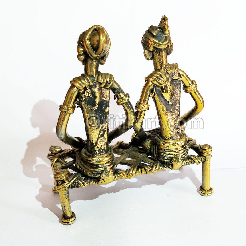 Tribal Couple Sitting on Charpai Dhokra Art Showpiece