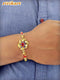 Golden Flower with Blue Stone Designer Rakhi