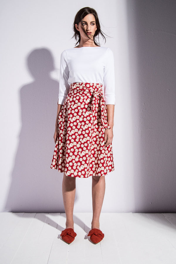 A-line skirt with tie belt and baseball print