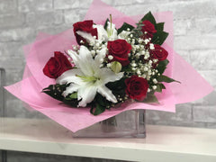 B28 - Half Dozen Roses with White Lily Bouquet