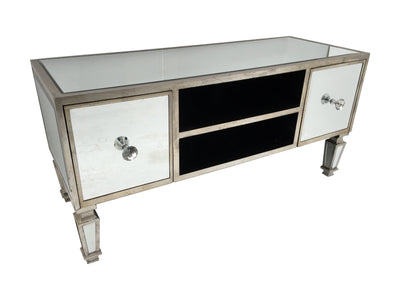 Mirrored TV unit with two drawers on each side and two shelves between them. Features bevelled mirrored panels, diamante handles and antiqued silver finish