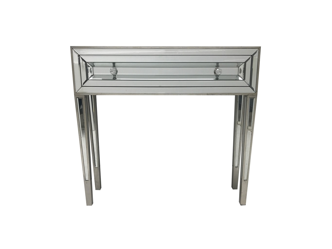 Mirrored console table with one drawer and two diamante handles, front view.