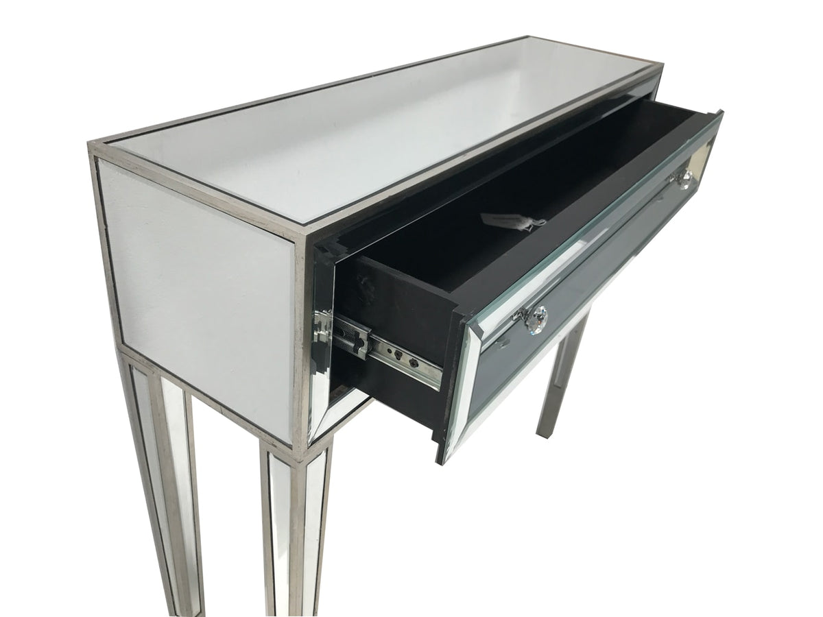 Glass console table with one open drawer, view from the front right angle