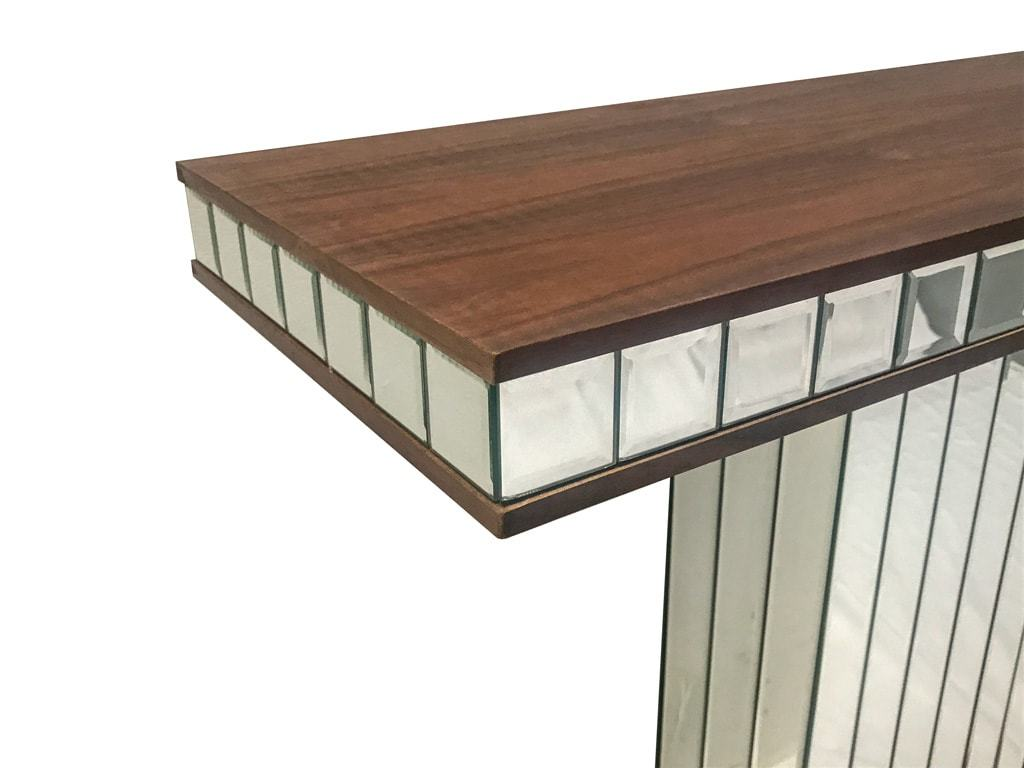 Mirrored console table with wooden top, closeup on table top