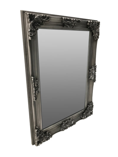 Wall Mounted Swept Frame Mirror in Antiqued Silver Colour, view from the right front angle