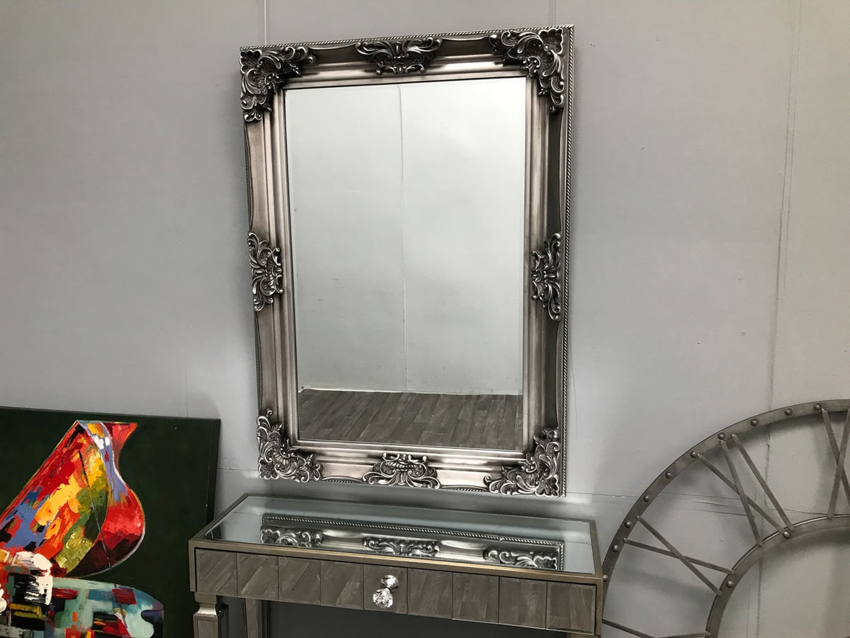 Wall Mounted Swept Frame Mirror in Antiqued Silver Colour