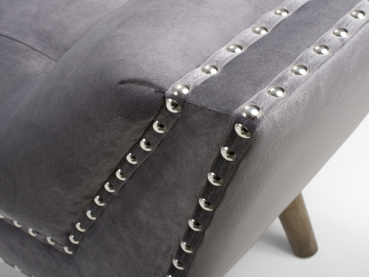 Bench seat with chrome studs detailing on grey velvet upholstery