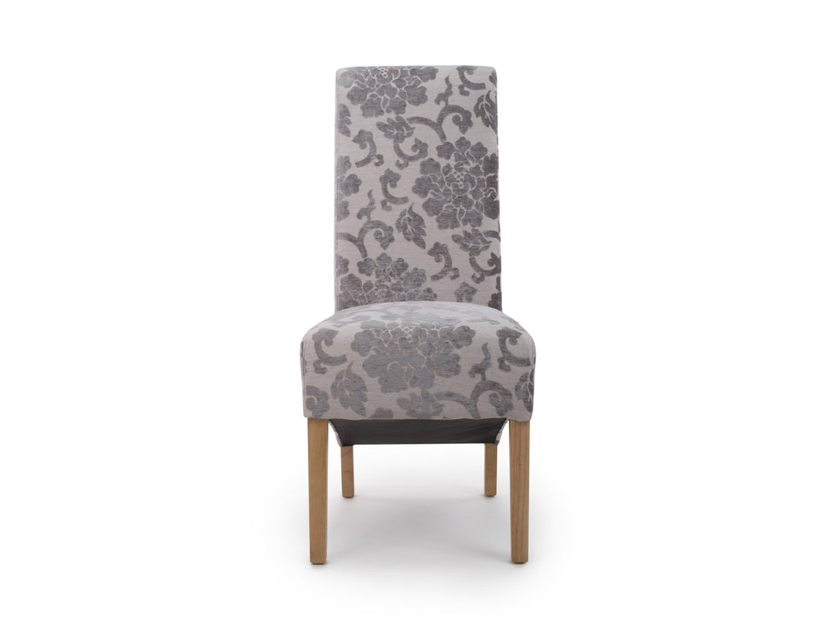 Elegant dining chair in light pink velvet upholstery, floral pattern