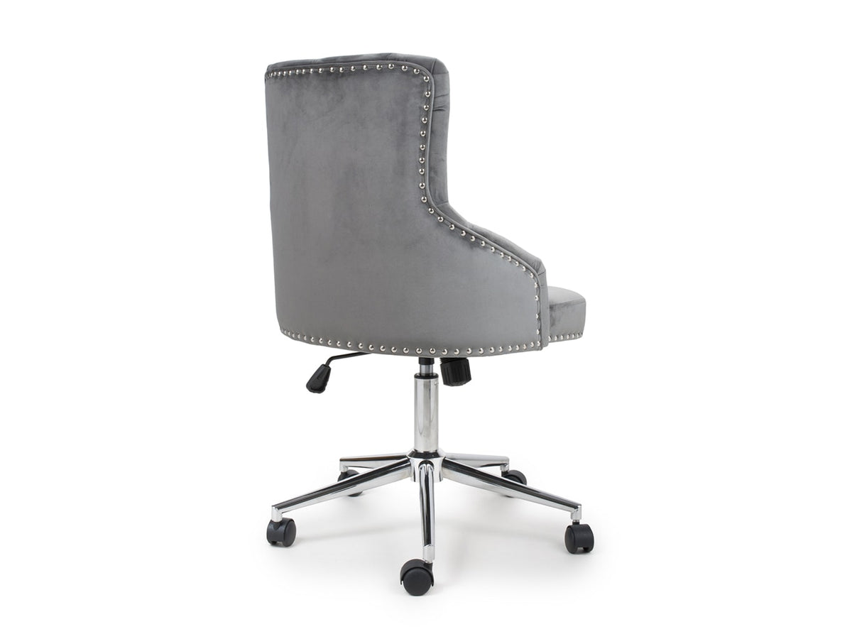 Office chair with metal stud detailing on chrome base with castors