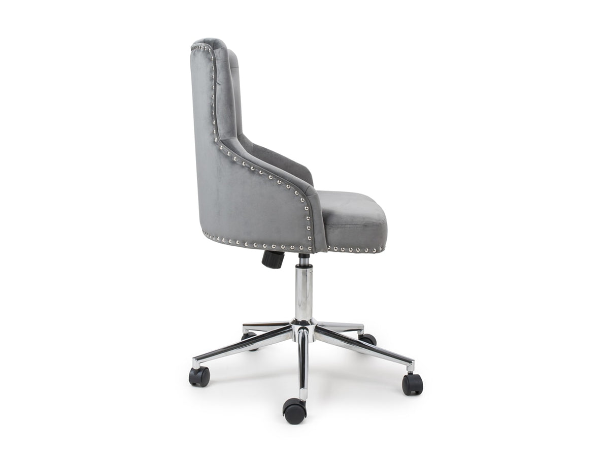 Office chair on wheels  featuring nail heads and grey velvet upholstery