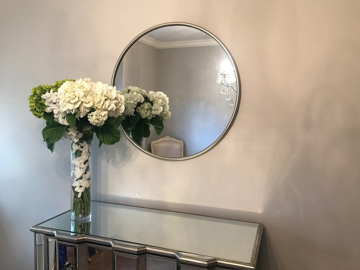 silver round mirror wall mounted