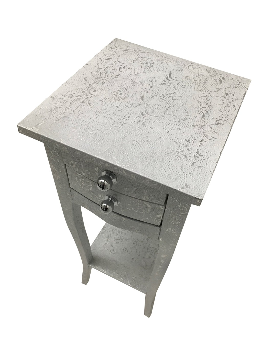 White compact bedside table with drawers and a shelf, metal embossed