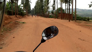 Moto ride in Rwanda searching for coffee