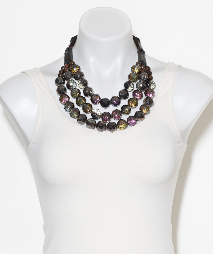 MULTISTRAND BEADED AND WOOD BAR STATEMENT NECKLACE. PURPLE/BROWN