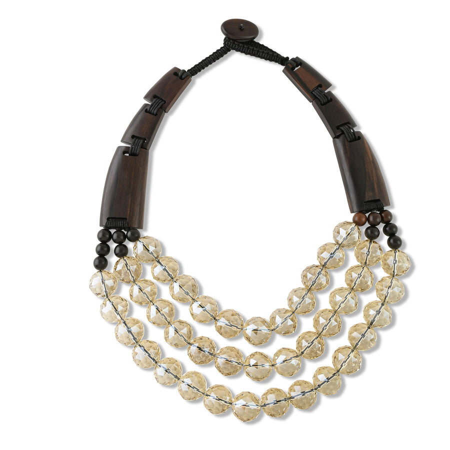 MULTISTRAND BEADED AND WOOD BAR STATEMENT NECKLACE. CLEAR/BROWN
