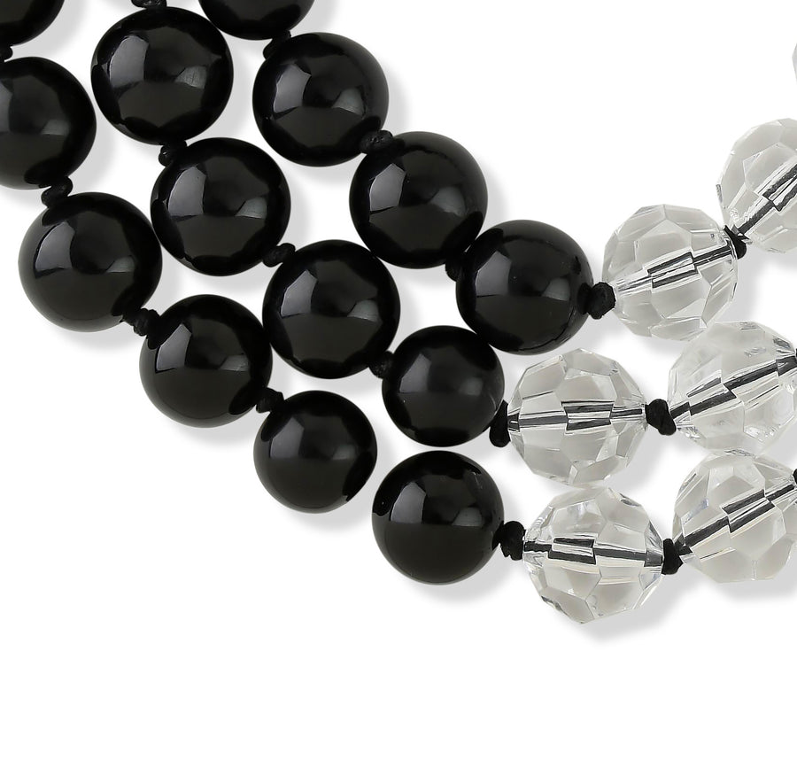 THREE STRAND FACETED BEADED NECKLACE. CLEAR/BLACK