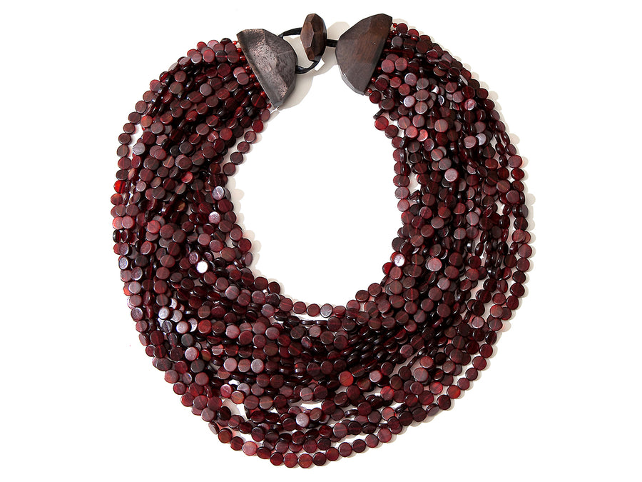 TWENTY STRAND NAIL AND WOOD DRAPE NECKLACE. MAROON