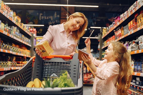 woman shopping with daughter, family time
