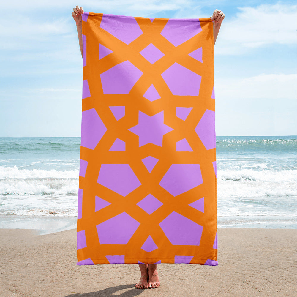 Towel with bright pink and orange geometric pattern