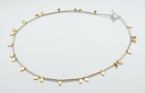 Silver necklace with tiny gold plated ovals