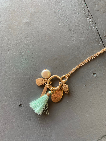 Gold Charm Necklace with Teal Tassle