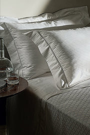 Madison Collection Cotton Blanket on bed angled