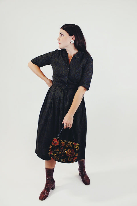 vintage 1950's paisley printed midi length dress with 3/4 arms and button up bust with small collar dark green front