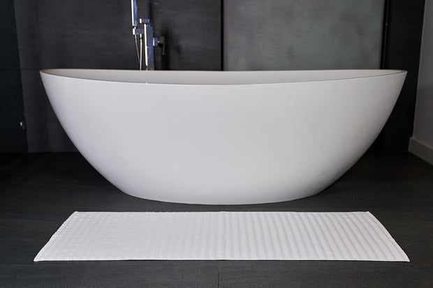 Madison Collection Wave Bath Mat in front of tub