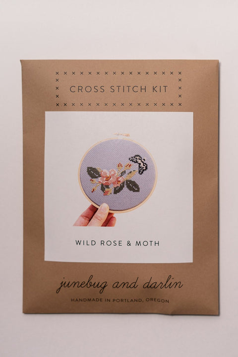 junebug and darlin Wild Rose and Moth Cross Stitch Kit in package, front