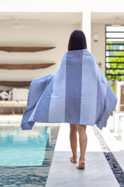 Madison Collection Striped Pool Towel wrapped around woman