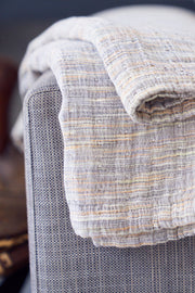 Madison Colleciton Printed Yarn Blanket on arm of chair