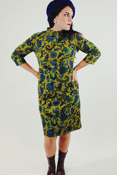 Green and blue paisley printed midi dress with mock neck and 3/4 length sleeves front