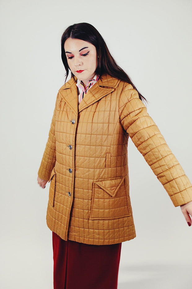 women's brown quilted puffer jacket double lapel front pockets hits above the knee side