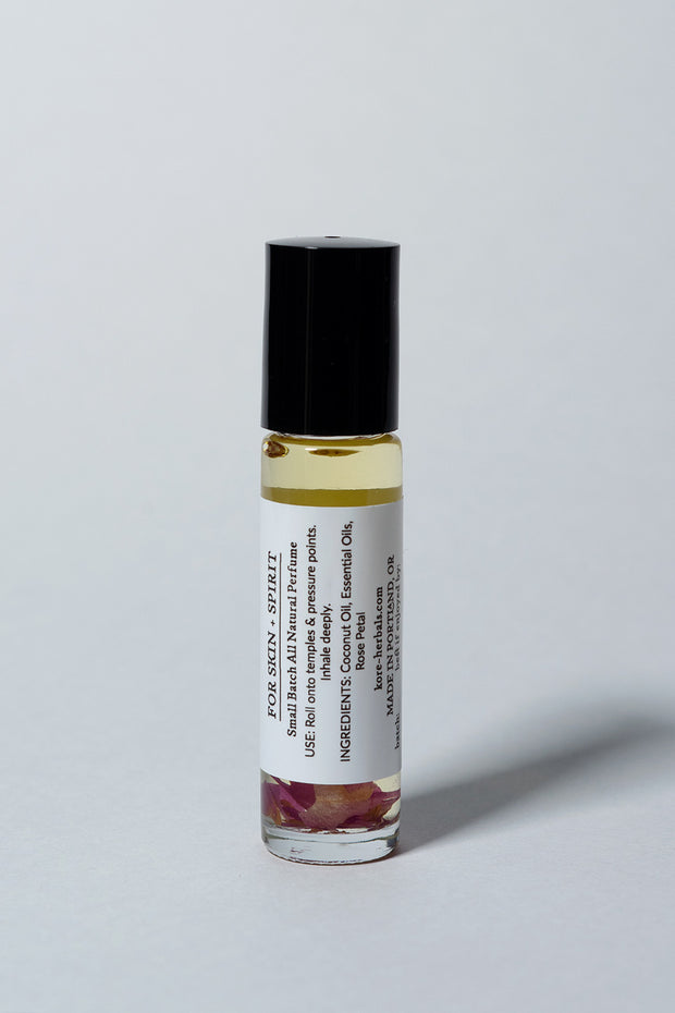 Kore Herbals Vanilla + Rose Perfume Roller on white background back