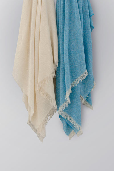 Madison Collection Air Collection Throw hanging blue and sand